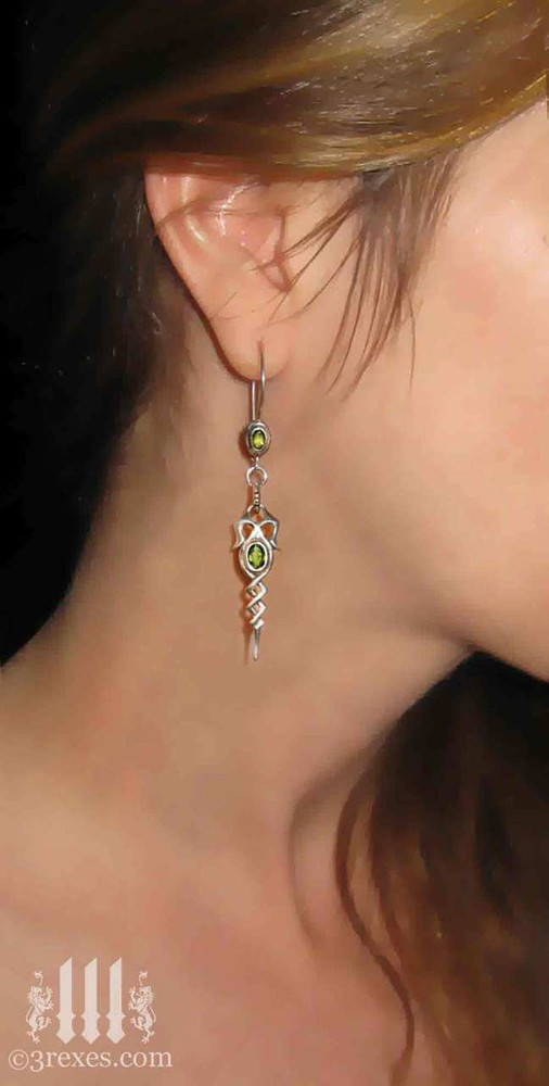 .925 sterling silver dripping celtic earrings with green peridot on model