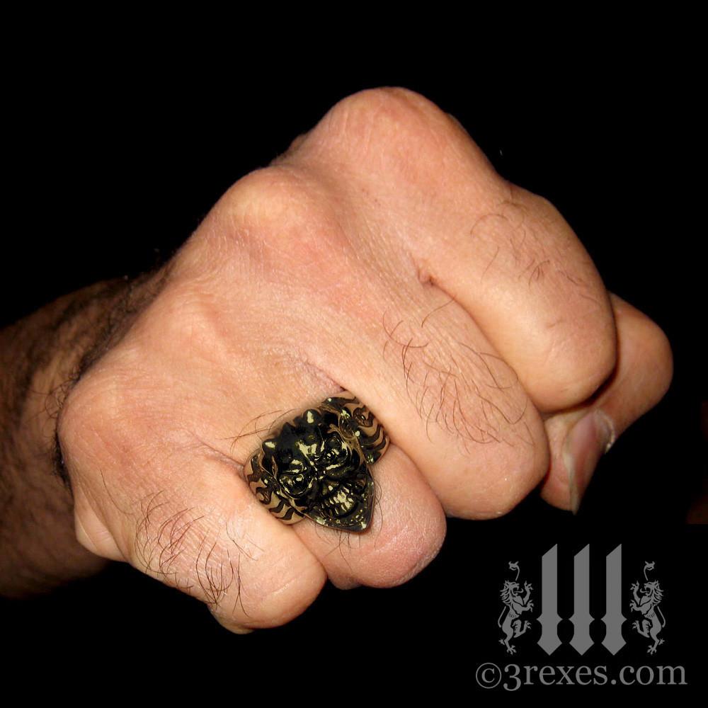 brass gargoyle devil ring on fist