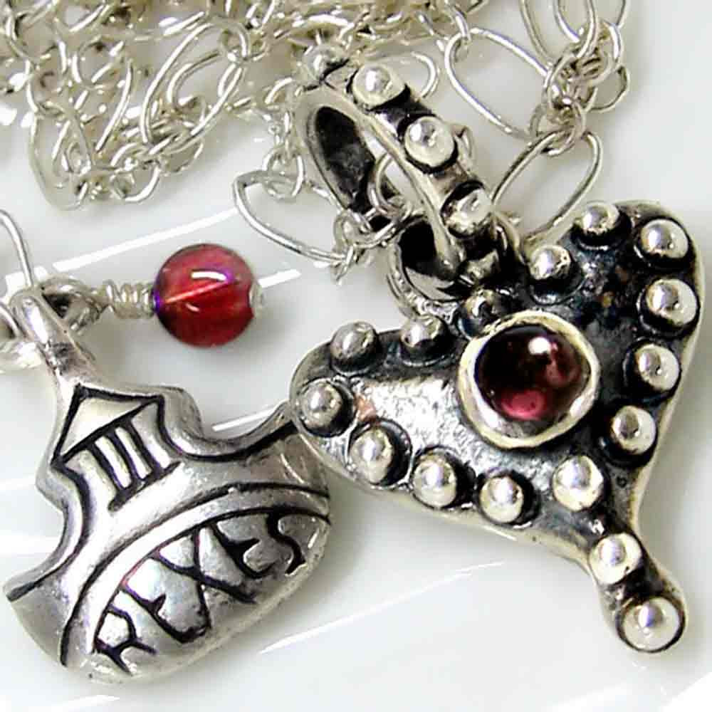 medieval fairy tale silver studded heart necklace with garnet detail