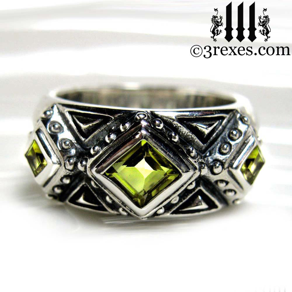 silver gothic wedding ring with green peridot stones .925 sterling silver