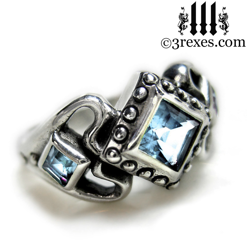 princess love gothic engagement ring with light blue topaz