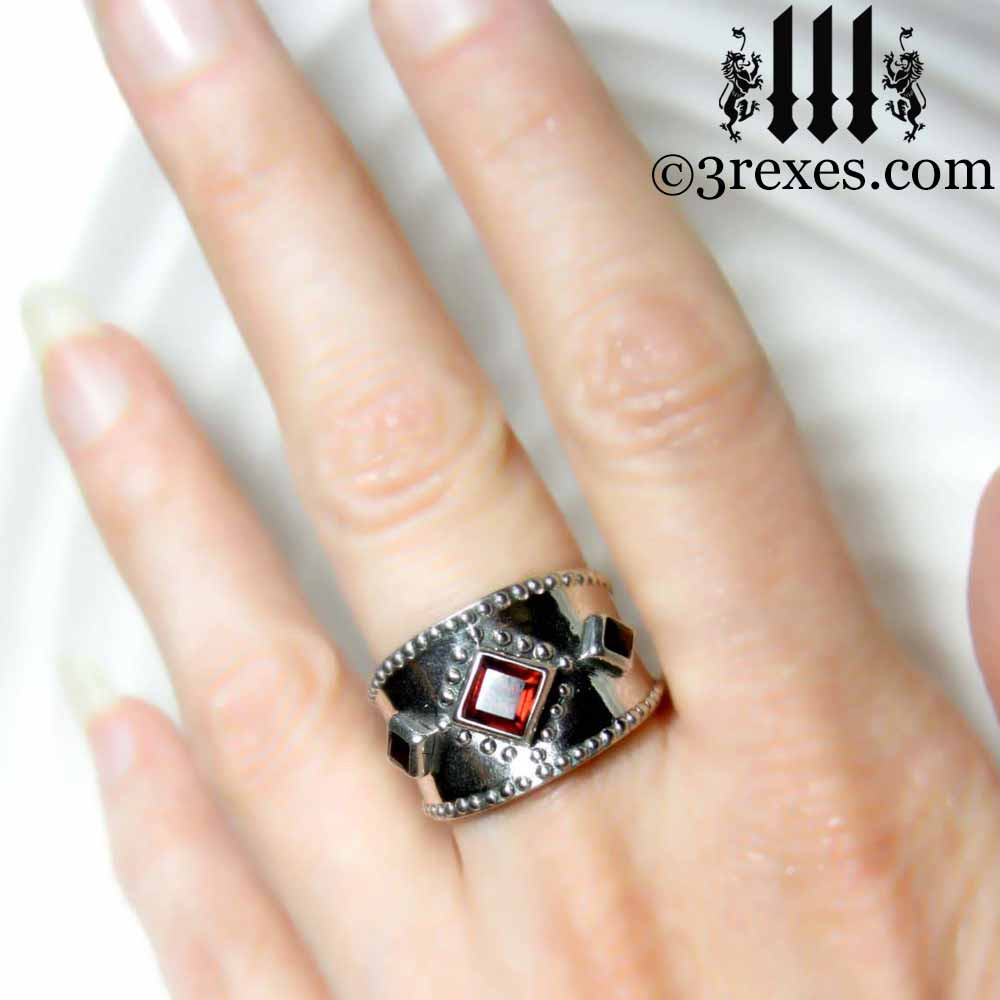 silver medieval ring worn on the middle finger