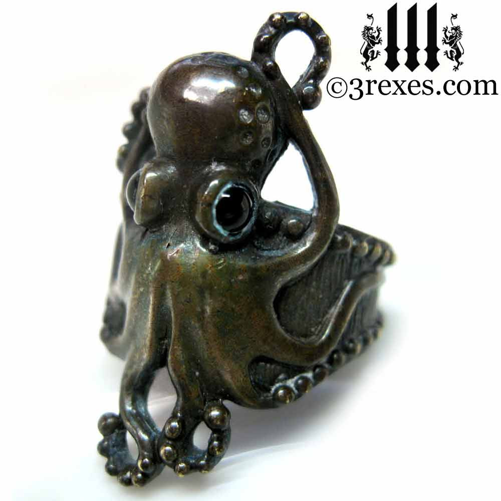 antiqued brass octopus ring with black onyx cabochon eyes