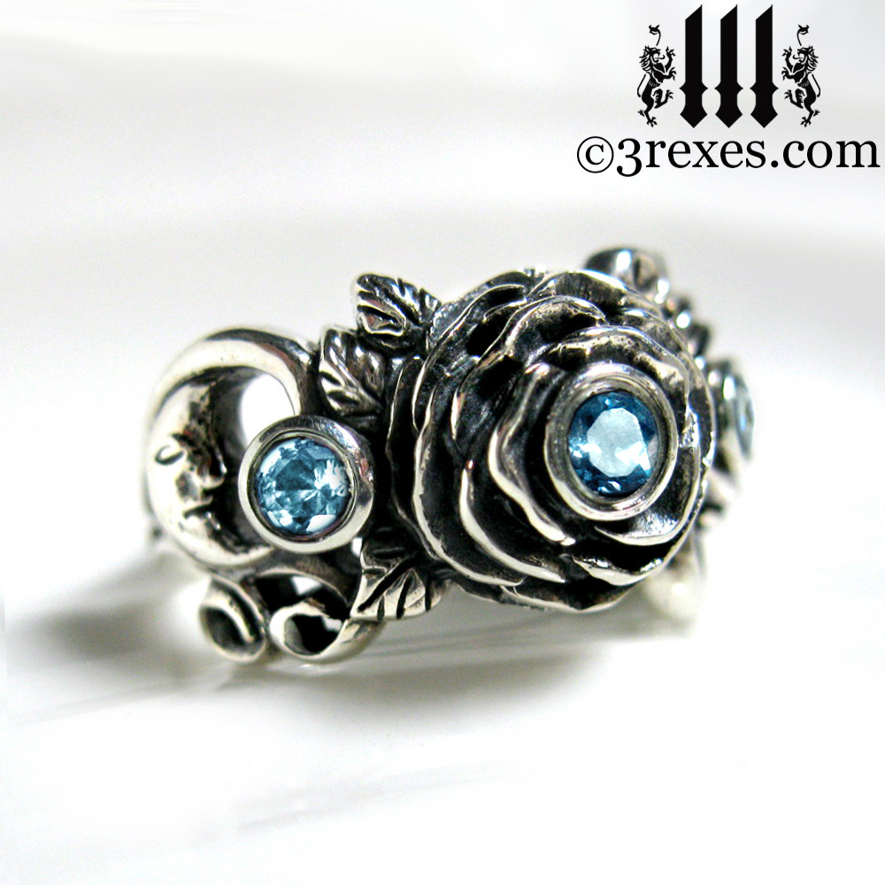 gothic silver rose moon spider ring with blue topaz faceted stone