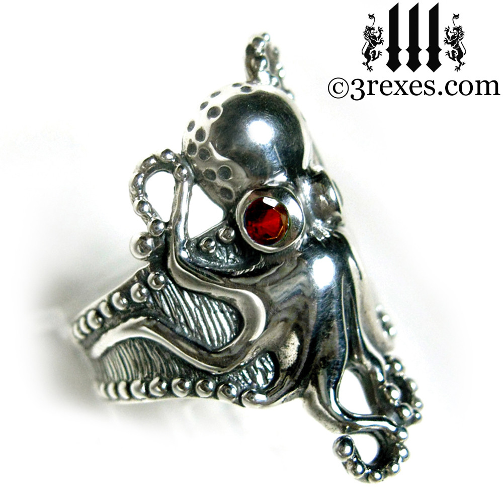 octopus ring with garnet faceted eyes