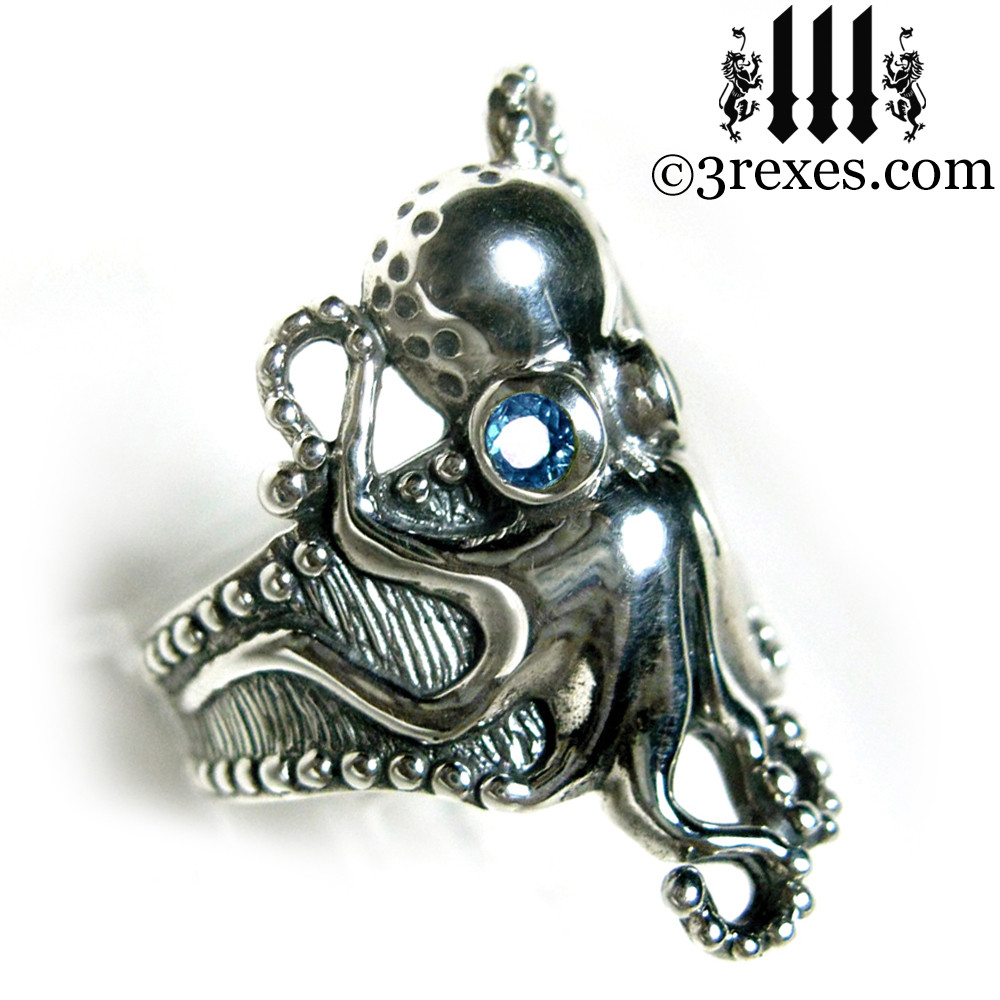 octopus ring with blue topaz faceted eyes