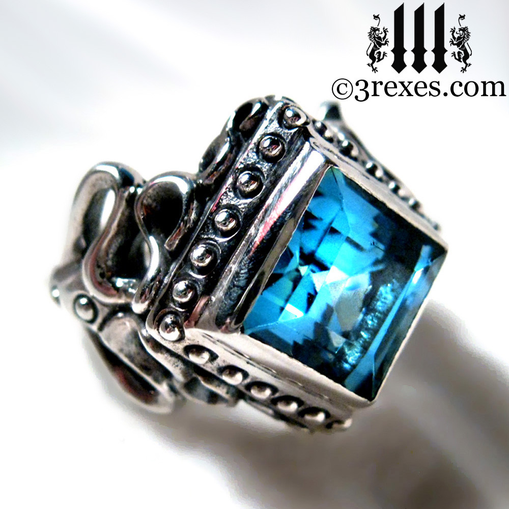 gothic wedding ring with blue topaz