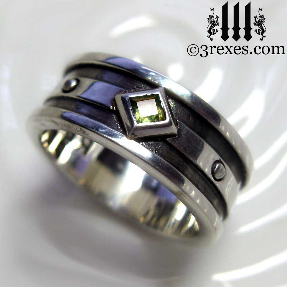 silver gothic wedding ring with green peridot stone
