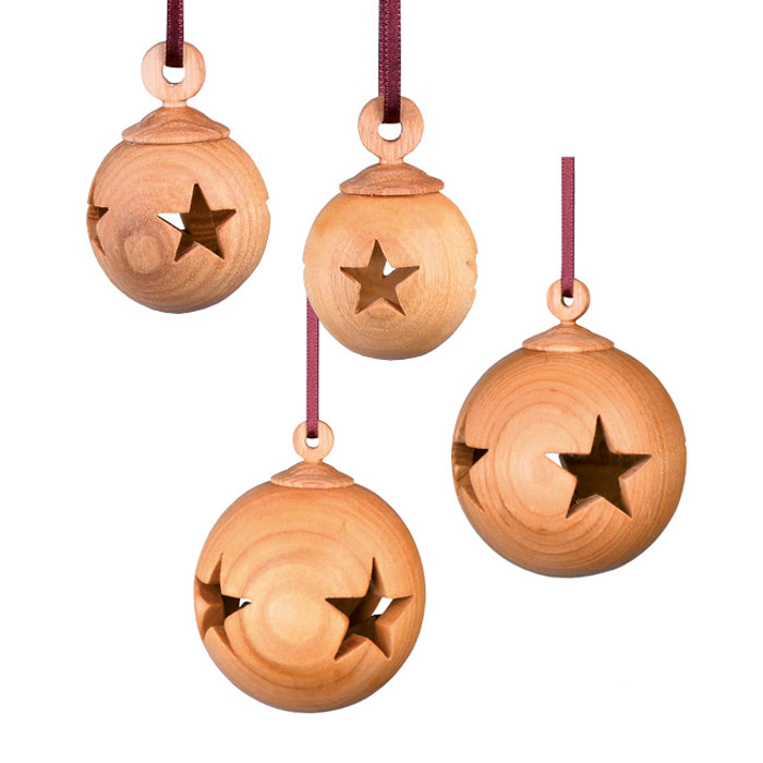 Wooden Christmas tree ornaments with star cut-outs.  3 and 6 cm diameter.  Made in Germany.
