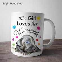 This girl loves her Weimaraner