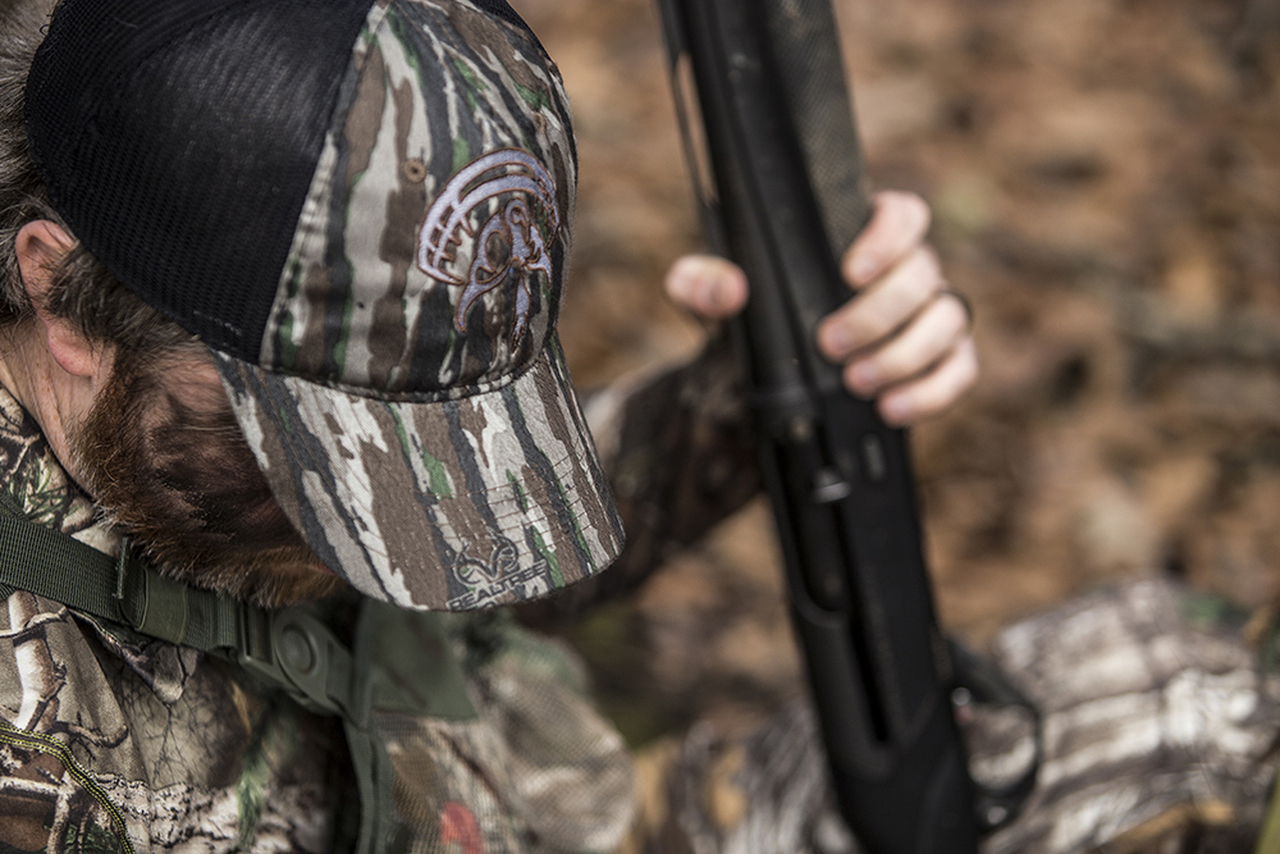 The perfect turkey hunting cap- Original Real Tree camo, black mesh, velcro closure and embroidered Strut Commander logo.
