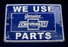 Metal - Tin 3-D Embossed Sign WE USE GENUINE CHEVROLET PARTS