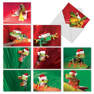 A tree frog is featured in these fun photos where he wears a Santa hat and rests on a log.
