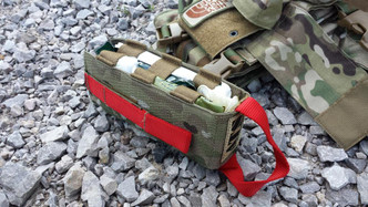 The Low Profile Medical Insert is designed to work specifically with our Low Profile Chest Harness, but it will work with almost any small pouch including our Small Utility Pouch. It is a simple clam shell design that will hold just enough medical kit to treat severe trauma wounds. A red pull handle and securing strap help to designate the insert as carrying life saving supplies. As with all of our products the Low Profile Medical Insert is made in the USA of the highest quality mil-spec materials.