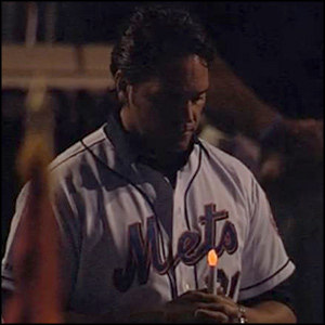 Mets player with battery operated candle
