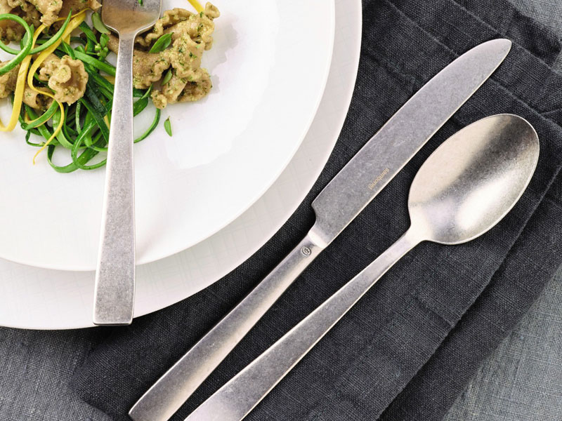 Sambonet Flat Vintage flatware - Fork, knife and table spoon on dark table linen.