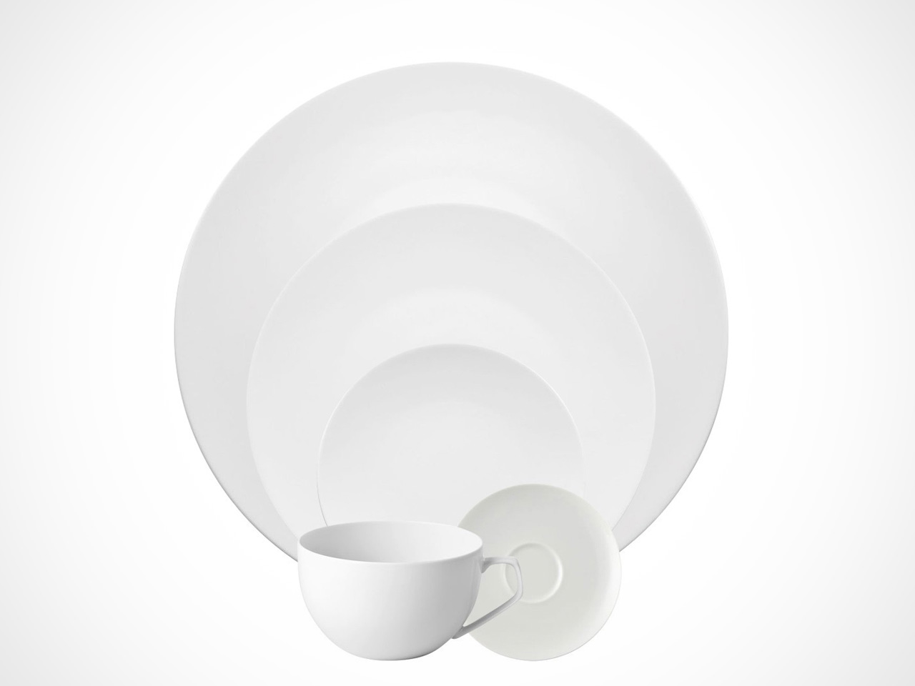 Rosenthal TAC 02 White 5 piece place setting on white background.