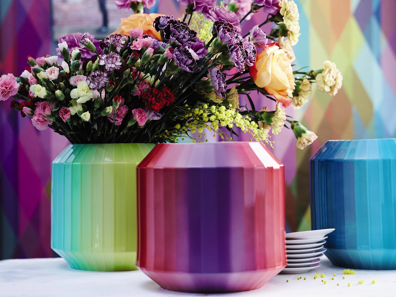 Colorful Rosenthal Hot Spot Vases with flowers in front of colorful background.