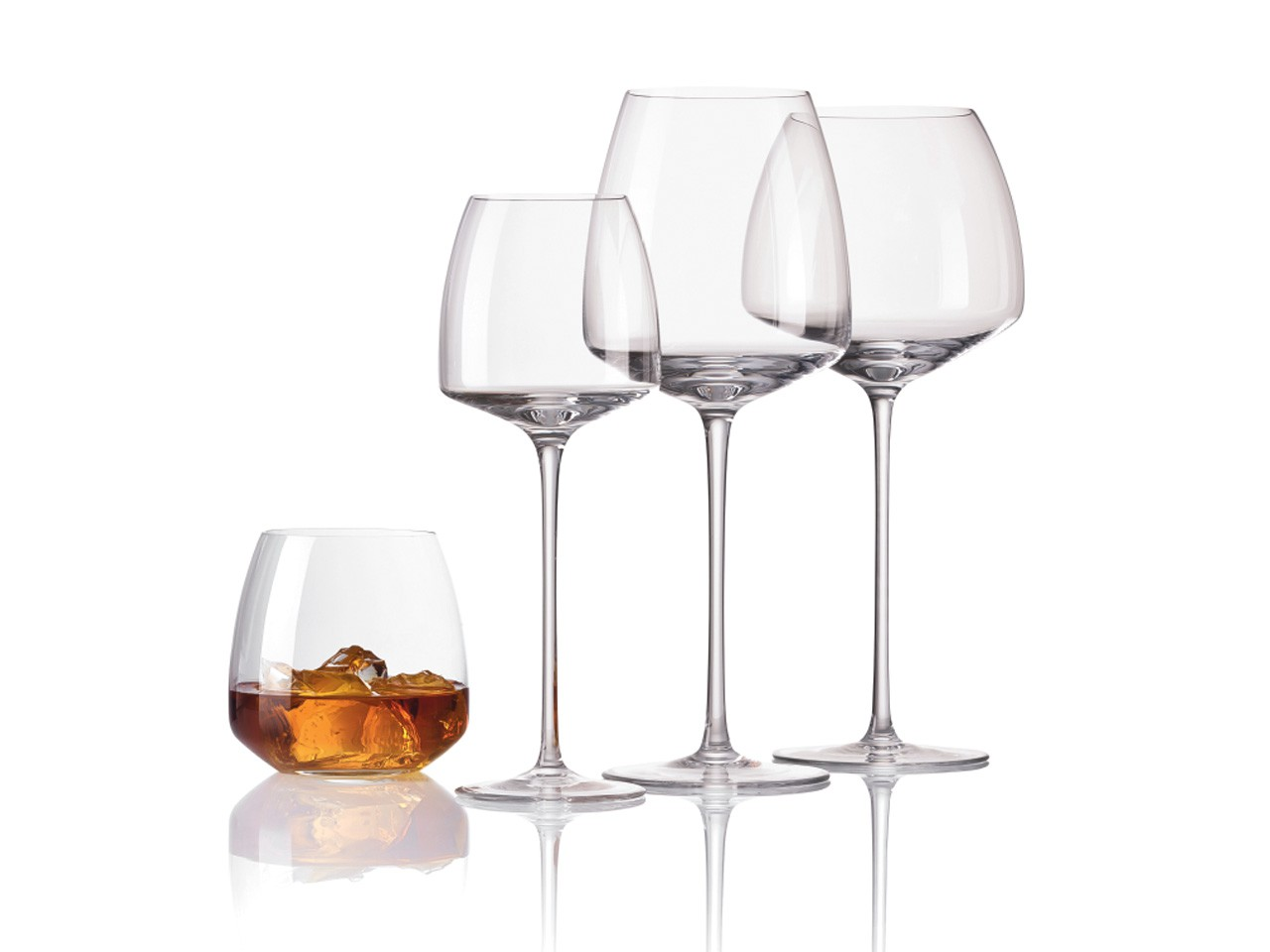 3 Rosenthal TAC 02 wine glasses and 1 TAC 02 whiskey glass on mirrored surface.