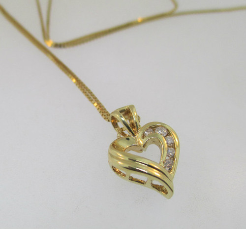 14k yellow gold heart shaped pendant with approx 25ct tw of 14k yellow gold heart shaped pendant with approx 25ct tw of diamonds accenting the aloadofball Gallery