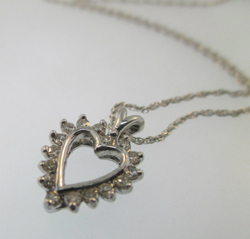 14k white gold heart shaped pendant with approx 25ct tw of channel 14k white gold heart shaped pendant with approx 25ct tw of channel set diamonds aloadofball Choice Image