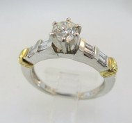 Platinum and 18k Yellow Gold Ring with Approx .40ct Round Brilliant Cut Diamond with Baguette Diamond Accents. Size 6 ¼