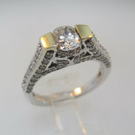 18k White Gold Approx 1.17ct TW Round Brilliant Cut Diamond with Accent Diamonds Surrounding Mount. Size 6 ½ *
