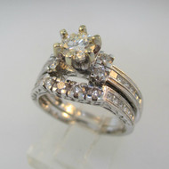 18k White Gold Approx 1.37ct TW Round Brilliant Cut Diamond with Princess Cut Diamonds on Side. Size 5 ¾ *