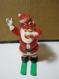 Vintage Hard Plastic Santa on Skis Blowing Horn Candy Container