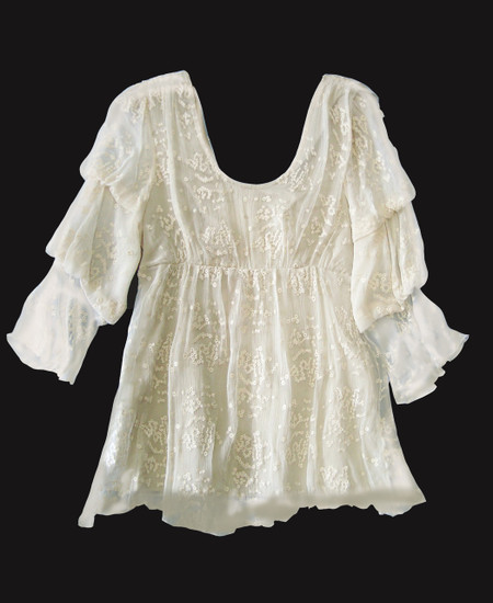 """Sagrada - Romantic blouse with 3 tiered puff sheer sleeves and empire line bodice, featuring scoop front neckline and truncated """"V"""" back neckline and a lined bodice.  made of 100% silk textured georgette delicately embroidered with cotton thread in """"droplet"""" pattern."""